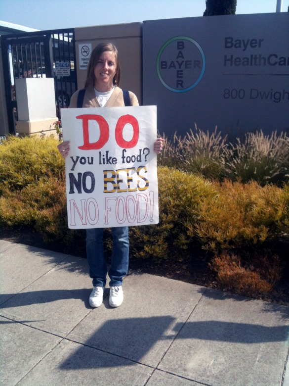 Alisha the Explorer outside Bayer's offices in Berkeley © 2012 Pollinator Support Movement